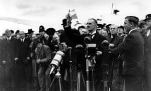Neville Chamberlain at Heston Airport on his return from Munich after meeting with Hitler, September 1938.