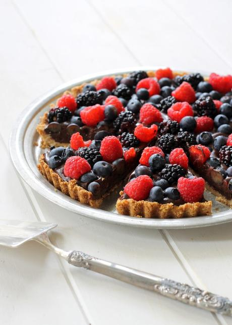 This Chocolate Berry Tart has vegan chocolate ganache in an almond flour crust, topped with fresh berries! This easy, impressive dessert recipe is Paleo, gluten-free, vegan and refined sugar-free.
