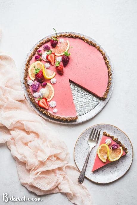 This Vegan Strawberry Lemonade Tart is a no-bake, gluten-free and paleo recipe made with loads of fresh strawberries and lemons. The scrumptious agar-thickened filling plays perfectly with the date-sweetened hazelnut crust.