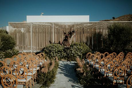 Rustic summer wedding in Nicosia with string lights and flowers in vivid colors | Joy & Pierre