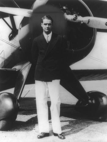 The Aviator: Leo's Navy Jacket and White Slacks