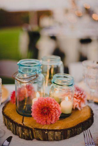 mason jars wedding centerpieces candles in blue glass mason jar and red dahlia ryan flynn photography
