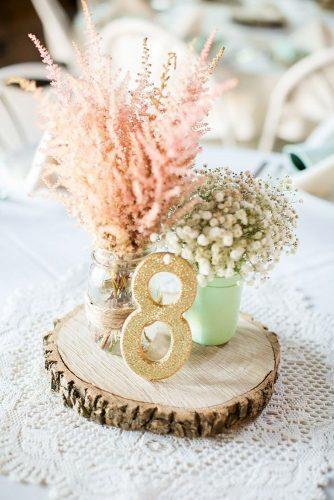 mason jars wedding centerpieces with baby breath and glitter tablenumber caynay photo