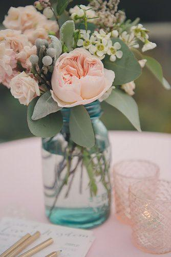 mason jars wedding centerpieces gentle pink flowers in blue glass rebecca amber photography via instagram