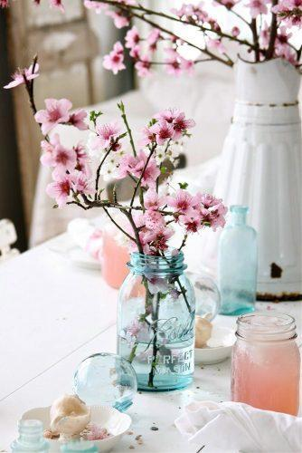 mason jars wedding centerpieces cherry blossom in blue glass dreamywhiteslifestyle via instagram