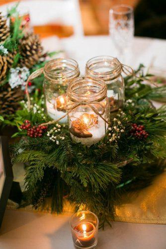 mason jars wedding centerpieces candles in mason jar fir branches winter reception decor tpoz photography