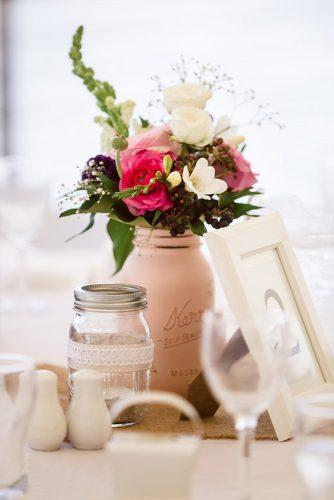 mason jars wedding centerpieces in the center of the table a beige jar with flowers beach blues