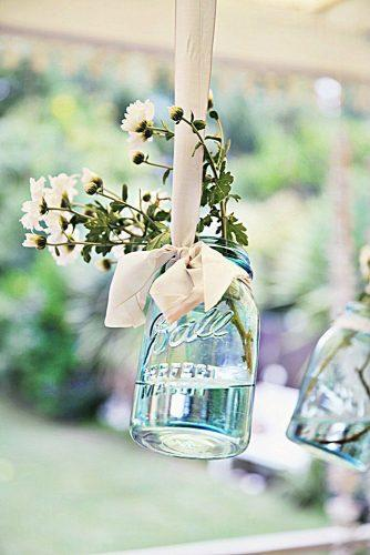 mason jars wedding centerpieces blue glass suspended with flowers abeachcottage via instagram
