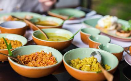 Coconut sambal and curry close up on table with Sri Lankan food, Asia