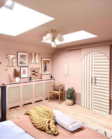 Sophisticated blush pink bedroom decor with muted gallery wall