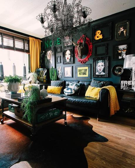 Black living room decor with quirky prints and wall art