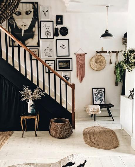 Monochrome hallway decor with staircase gallery wall