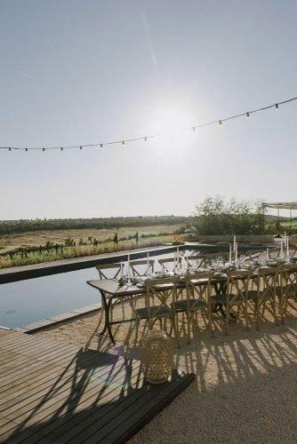 vine yard wedding weekend extravaganza table near pool zeev_damon