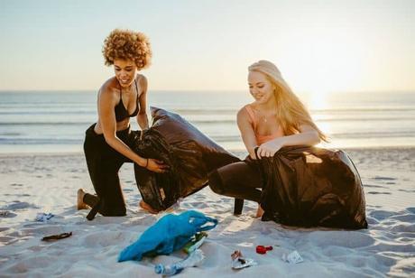 women-cleaning-beach-litter