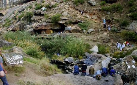 fertility cave caves africa men praying