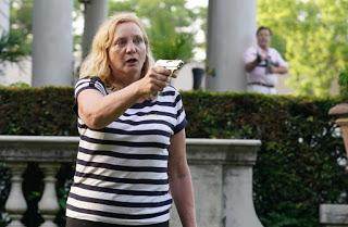 Mark and Patricia McCloskey, husband-wife lawyers, break out weaponry when protesters appear in front of their million-dollar home in St. Louis neighborhood