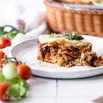 This is the BEST Vegan Lasagna! It's layered with vegan almond ricotta, mushroom tempeh marinara sauce, and topped with a simple vegan mozzarella cheese that bubbles and browns. It's easy to make gluten-free as well!