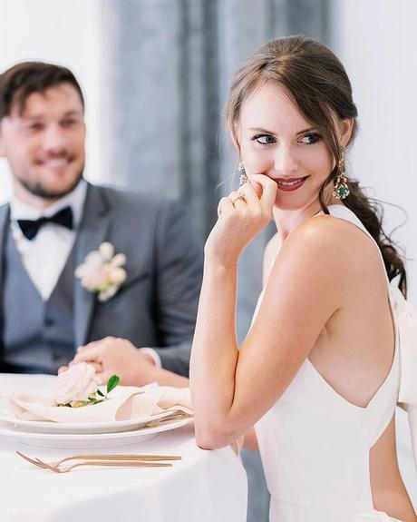 how to tip wedding vendors newlyweds sitting at the table