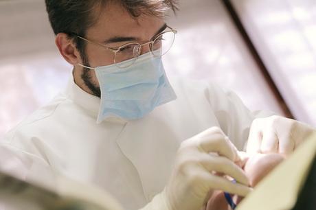 man-in-white-dress-shirt-wearing-gold-framed-eyeglasses-3779704
