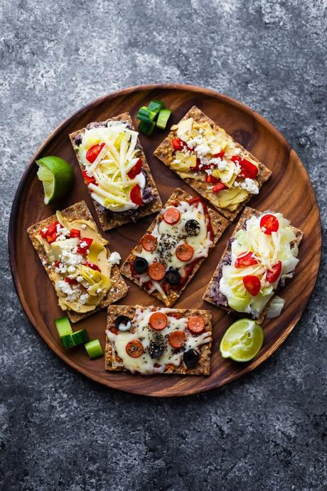 open-faced sandwiches on wooden platter