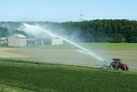 tractor-irrigating-watering-field