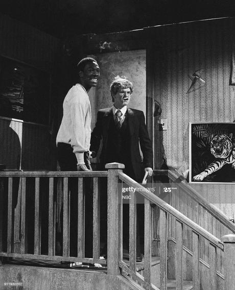 Eddie Murphy as Mr. Robinson, Tim Kazurinsky as Mr. Landlord ...