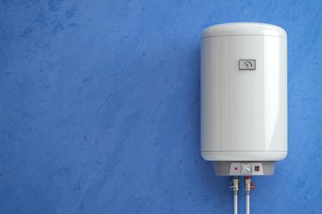 Electric boiler on blue wall