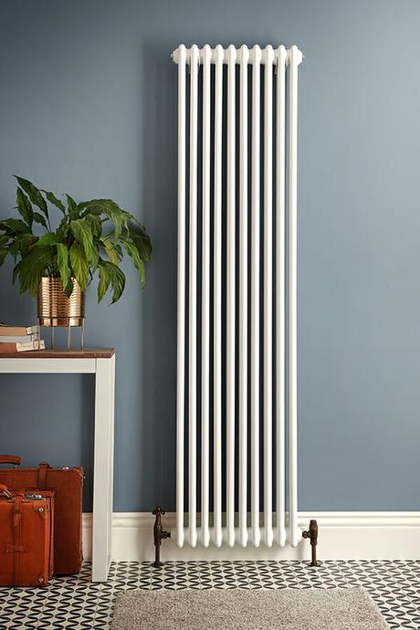 a tall white milano windsor radiator on a blue background