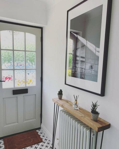 a white column radiator with a shelf above