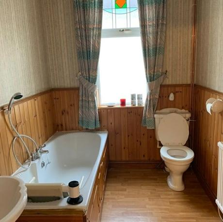 A wooden clad bathroom space