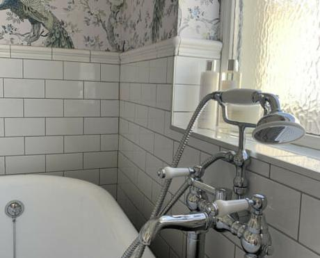 a traditional bath tap next to a bath