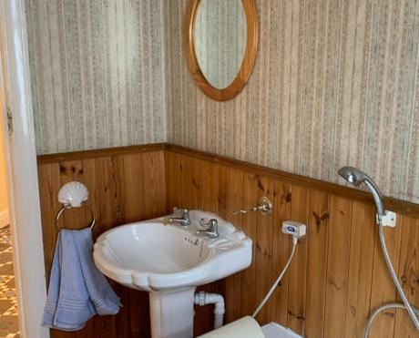 an old basin in a wooden bathroom