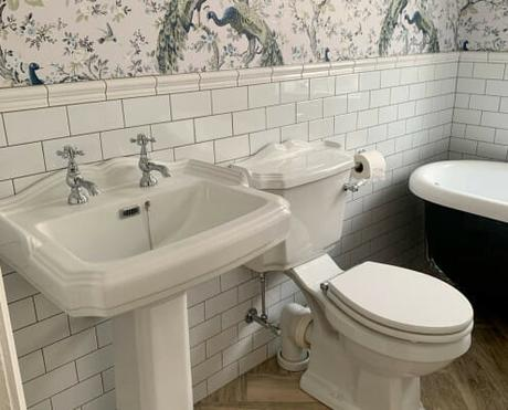 a basin and toilet in a traditional bathroom