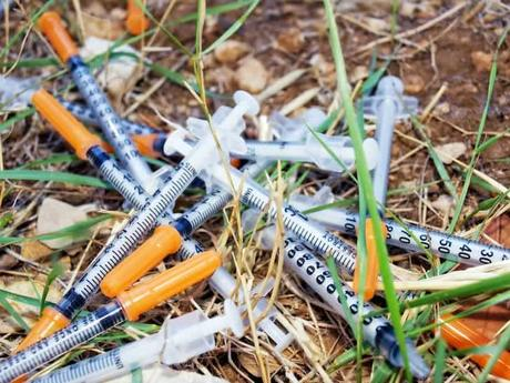 photo-narcotic-syringe-on-the-grass