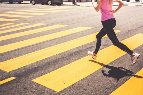 Blonde Woman Running Over The Pedestrian Crossing