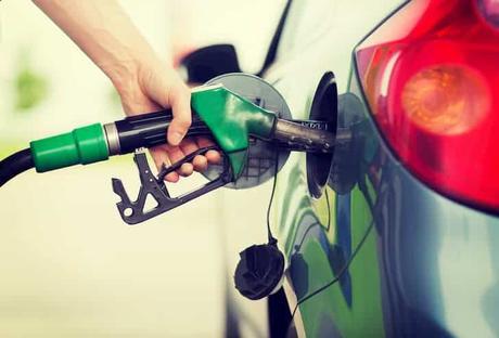 photo-man-pumping-gasoline-fuel-in-car