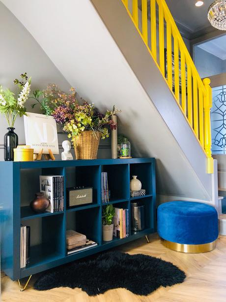 Unusual painted staircase with colourful yellow bannister