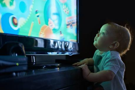 a Baby watching TV