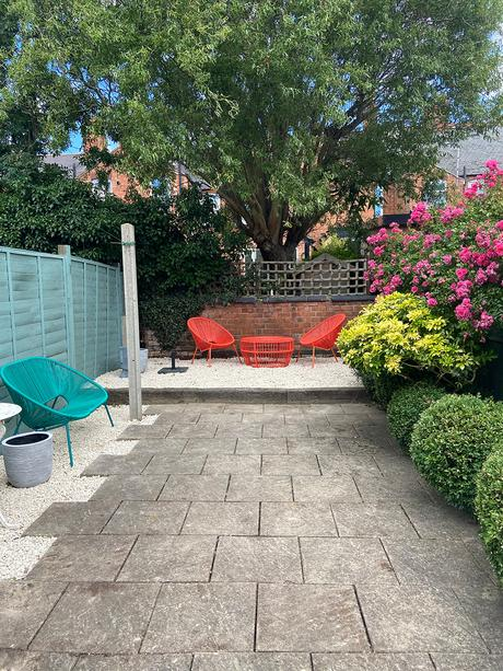 Adding a gravel patio for extra seating in the garden