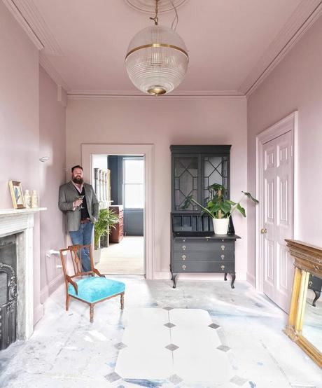 man stood in a pink room