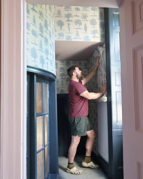 Greg putting up wallpaper