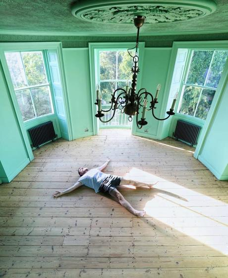 Greg lying on the floor in the party room