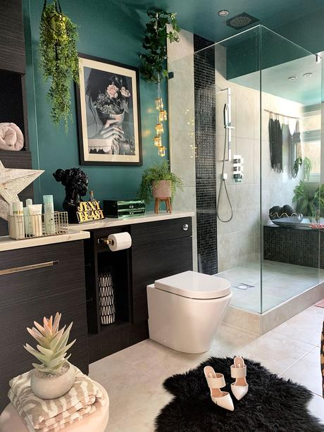 Quirky bathroom decor. Green and black color palette with lush green house plants