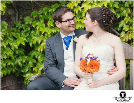 Quirky ytorkshire wedding couple at York St. John University with orange flowers