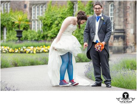 Quirky york wedding couple with blue rainbow converse boots