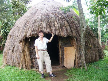 A very frumpy-looking Muzungu checking out the traditional accommodation option