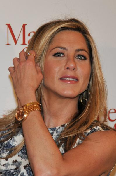 Jennifer Aniston showing off her Rolex Presidential