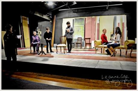 Actors on stage holding script with no set