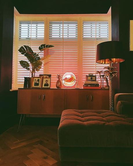 Eclectic living room - quirky lighting styled on a mid-century sideboard