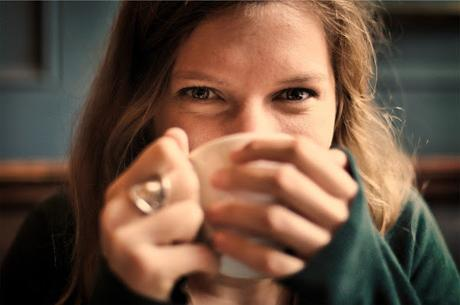 Image: Smiling girl drinking coffee in a mug, by StockSnap on Pixabay